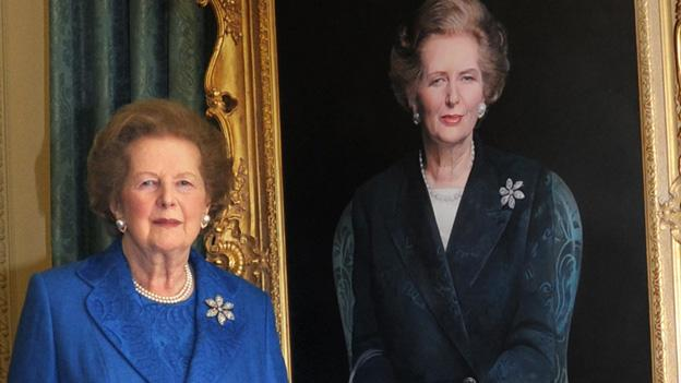 Former Prime Minister Margaret Thatcher, stands next to her portrait painted by artist Richard Stone, at 10 Downing Street in London. Thatchers former spokesman, Tim Bell, said that the former British Prime Minister Margaret Thatcher died Monday morning, April 8, 2013, of a stroke. She was 87.