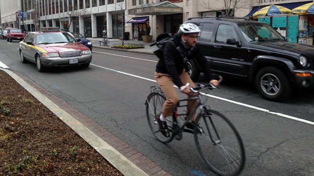 At the intersection of M Street, Rhode Island Avenue and Connecticut Avenue, cyclists still have to contend with traffic until the bike lane is completed.