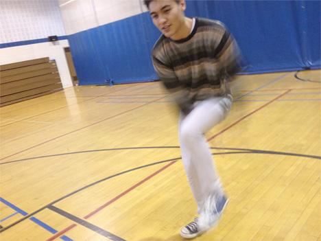 Brian Henriquez's is a blur as he performs step moves at the Herndon Community Center.