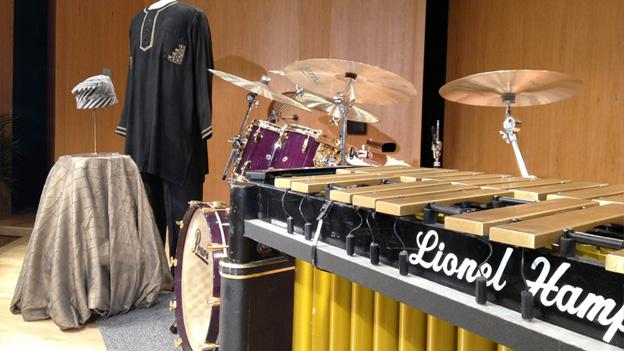 Randy Weston's robe and hat stand alongside the drum set of Horatio Hernandez and Lionel Hampton's vibraphone.