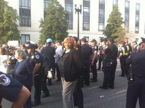 Council Member Yvette Alexander handcuffed at a protest over the federal budget deal April 11. A judge fined 6 of the protestors from that day $200 each.