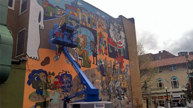 """A People without Murals is a Demuralized People"" is being restored after earthquake damage in 2011."