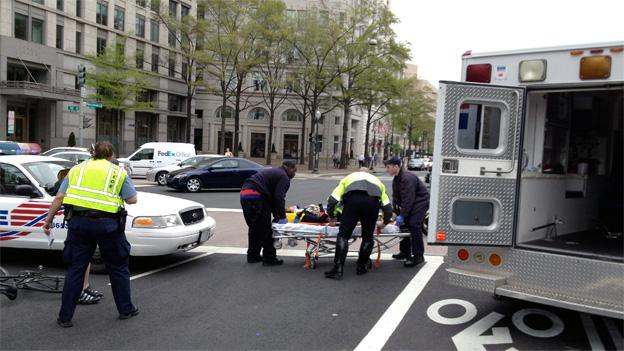 A pedestrian was taken away in a neck brace after being struck by a cyclist.