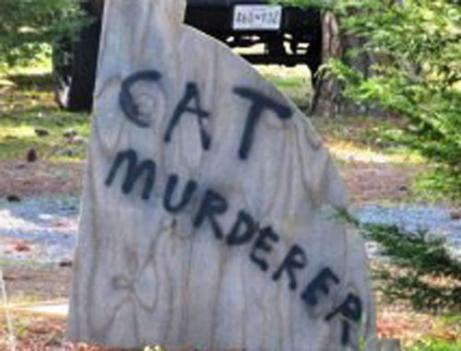 A makeshift sign posted in front of a house on Waterview Drive in Worcester County, Md. Some residents of the street say their neighbor rounded up housecats and brought them to the local animal control where they were euthanized.