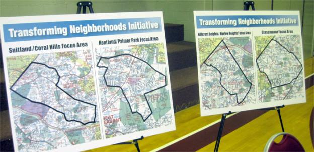 Posters outline the neighborhoods affected by the Transforming Neighborhoods Initiative.