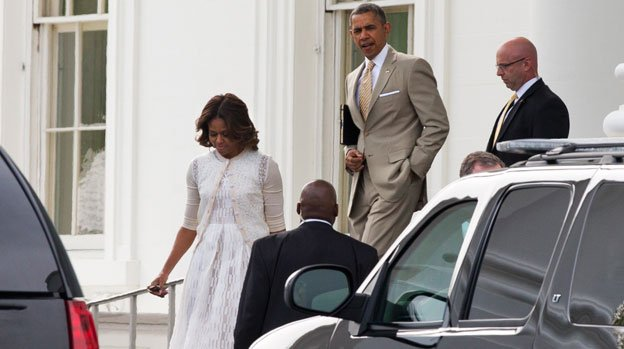 First lady Michelle Obama, left, and President Barack Obama walk to a motorcade from the White House to attend Easter services on Sunday, April 20, 2014, in Washington. The first family attended services at the Nineteenth Street Baptist Church in Washington.