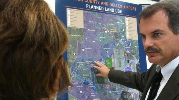 Members of the public questioned officials on proposals for a highway on the western side of the Dulles International Airport and public meetings last year.