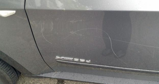 A photo posted by D.C. GOP candidate Tim Day showing his car after it was keyed.