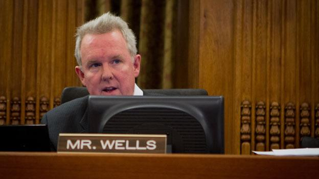 D.C. Council member Tommy Wells took aim at city officials for failing to follow through on two transportation programs this week.