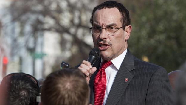 D.C. Mayor Vincent Gray makes a speech in April. Another one of Gray's campaign aides has been charged in an ongoing criminal investigation into the mayor's 2010 race.