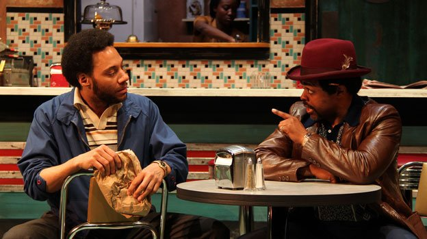 Sterling (Ricardo Frederick Evans) and Wolf (KenYatta Rogers) chat in Round House Theatre's production of Two Trains Running.