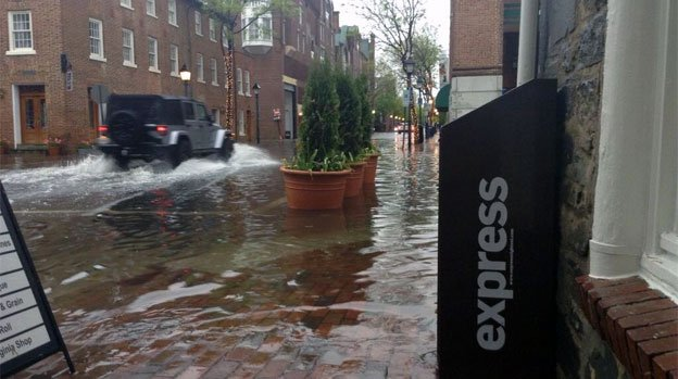 Two blocks up King Street in Old Town, Alexandria, there is as much as six inches of standing water.