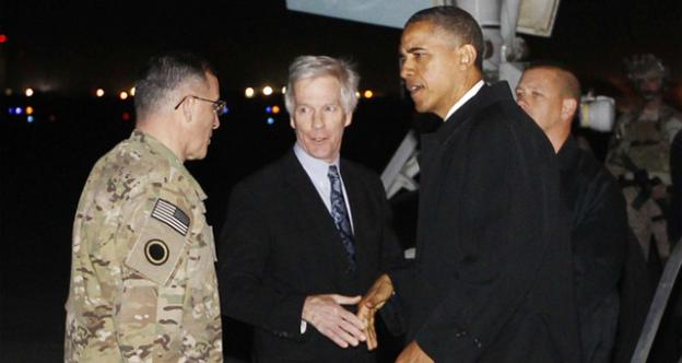 """President Barack Obama is greeted by Lt. Gen. Curtis """"Mike"""" Scaparrotti, and U.S. Ambassador to Afghanistan Ryan Crocker as he steps off Air Force One at Bagram Air Field in Afghanistan earlier today (Tuesday, May 1)"""