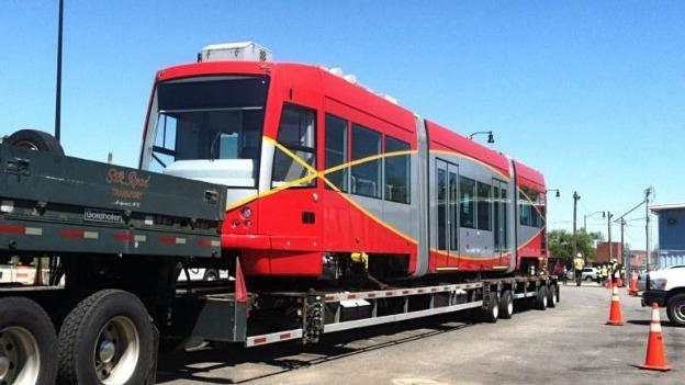 A D.C. streetcar being unloaded at a testing facility in Anacostia.