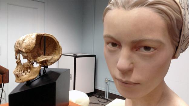"A facial recreation of the girl, known as ""Jane,"" stands next to the remains of her skull."