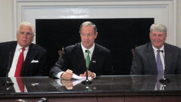 Maryland Governor Martin O'Malley, flanked by State Senate President Mike Miller, left, and Maryland House Speaker Michael Busch, signs several bills into law.