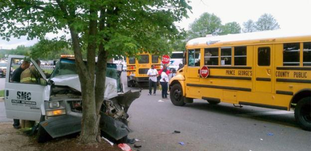 A utility van struck a tree after colliding with their rear of a PGCPS school bus.