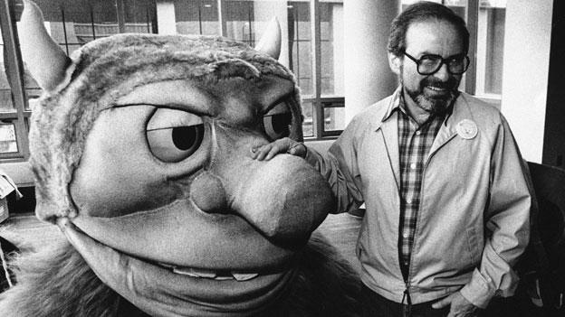 "In this September 1985 file photo, author Maurice Sendak poses with one of the characters from his book ""Where the Wild Things Are."""