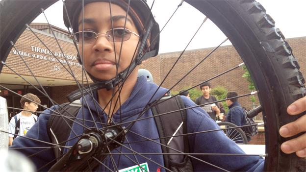 A student at Thomas Jefferson Middle School in Arlington, Va., shows off his tire at the event for National Bike to School Day.