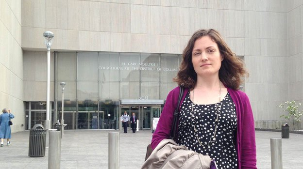 Kelly Dillon stands outside the courthouse, where she watched the trial of a man responsible for her injured legs.