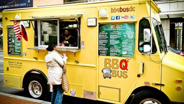 The BBQ Bus parked in front of the entrance to the Galleryplace-Chinatown Metro station.