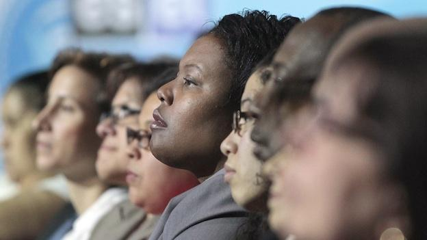 Washington DC Public School Interim Superintendent Kaya Henderson, center, sits in the audience as she listens to President Barack Obama talk with students, parents and teachers during a town hall at Bell Multicultural High School, in the Columbia Heights.