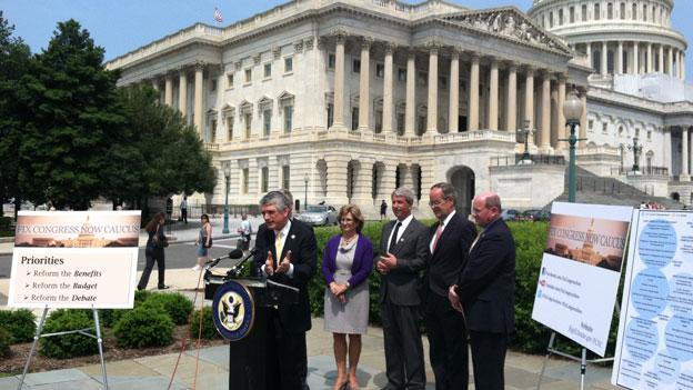 Rep. Scott Rigell (R-Va.) addresses reporters outside the Capitol with other members of the Fix Congress Now Caucus.
