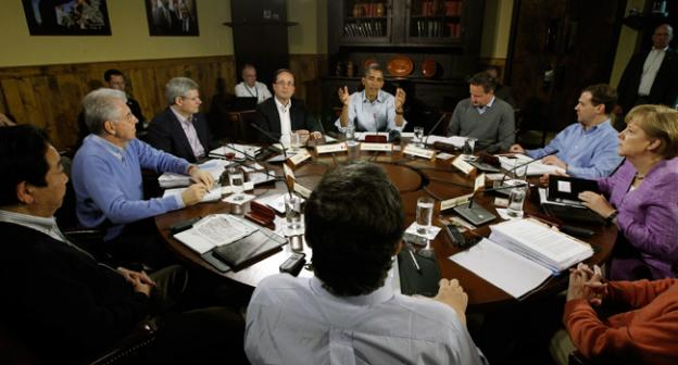 President Barack Obama, center, sits with world leaders at the start of the first session of the G-8 Summit Saturday, May 19, 2012 at Camp David, Md.