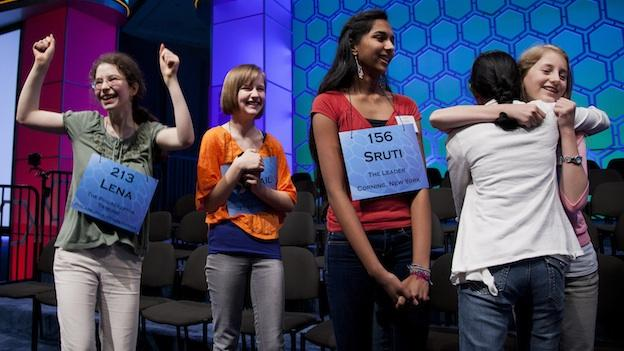 Contestants celebrate after learning they qualified for the semifinal round of the National Spelling Bee on Wednesday, May 30, 2012 in Oxon Hill, Md.