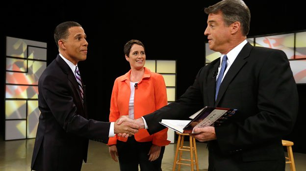 Democratic gubernatorial candidates, from left, Lt. Gov. Anthony Brown, Rep. Heather Mizeur, D-Montgomery, and Attorney General Doug Gansler chat before a Democratic gubernatorial primary debate at Maryland Public Television's studios in Owings Mills, Md., Monday, June 2, 2014.