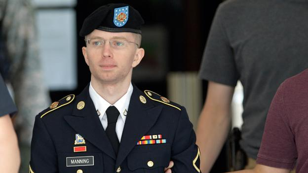 Army Pfc. Bradley Manning is escorted out of a courthouse in Fort Meade, Md., after the third day of his court martial. Manning is charged with indirectly aiding the enemy by sending troves of classified material to WikiLeaks.