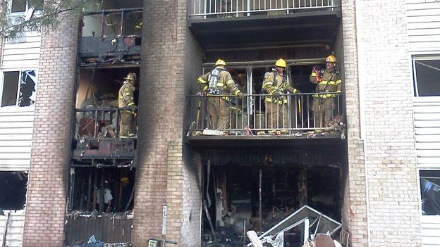 Firefighters survey the wreckage of a fire that ripped through part of a Suitland, Md. apartment complex June 6.