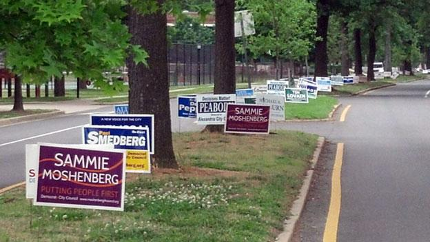 Campaign signs for candidates running in Tuesday's primary fill a median in Alexandria's Del Ray neighborhood.