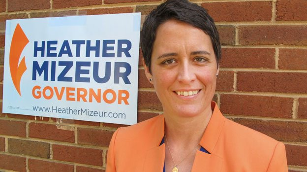 In this photo taken on Monday, May 19, 2014, Heather Mizeur, who is running in Maryland's Democratic primary for governor, stands in front of her campaign office in Silver Spring, Md.