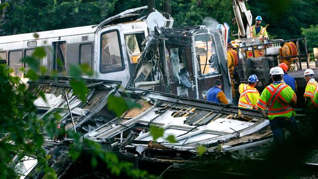 In this file photo from June 23, 2009 officials continue to work around the scene of a rush-hour collision between two Metro Red line trains in Northeast D.C.