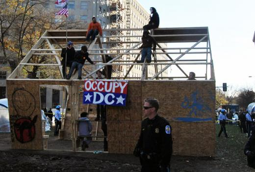 A judge convicted 11 Occupy DC protesters for failing to get down from an improvised wooden structure in McPherson Square.