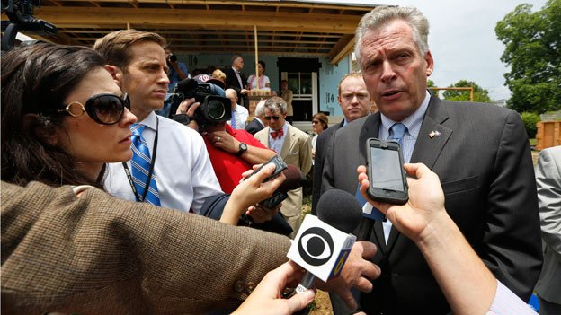Virginia Gov. Terry McAuliffe speaks to the media after a bill signing at a Habitat for Humanity house in Richmond, Va., Friday, June 13, 2014.