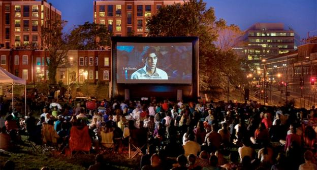 It is projected: movie goers enjoy a screening of Slumdog Millionaire at the outdoor film series in Northwest D.C.'s NoMa neighborhood.