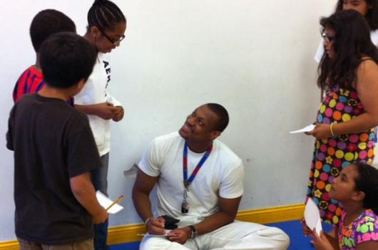 Mali native and taekwondo athlete Daba Modibo Keita signs autographs at the gym where he trains in Alexandria, Va.