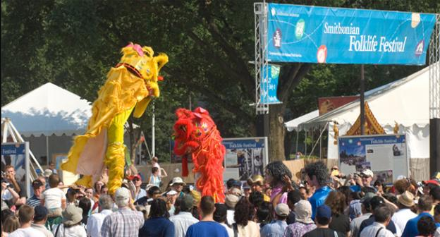 Visitors and participants take part in a procession out to the Spring Festival Ground where the closing ceremony for the 2007 Smithsonian Folklife Festival was to be held.