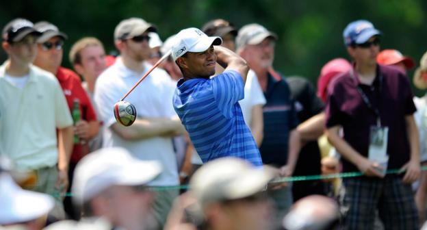 Tiger Woods watches his drive from the fourth tee during the second round of the AT&T National golf tournament at Congressional Country Club in Bethesda, Md., Friday, June 29.