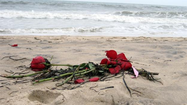 Roses were strewn along the beach for the two Ocean City police officers who died in a plane crash.
