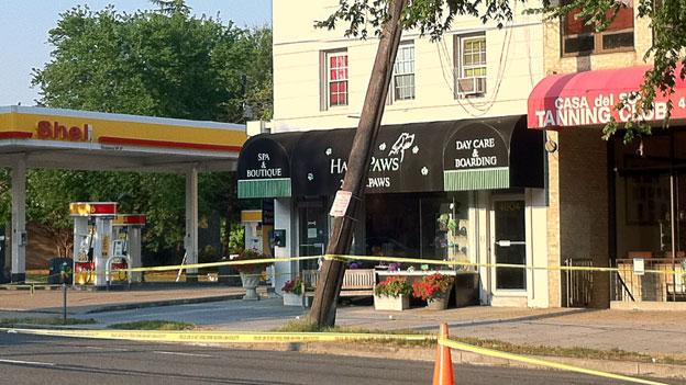 Damaged utility pole continues to lean and presents a danger to businesses along Wisconsin Avenue NW.