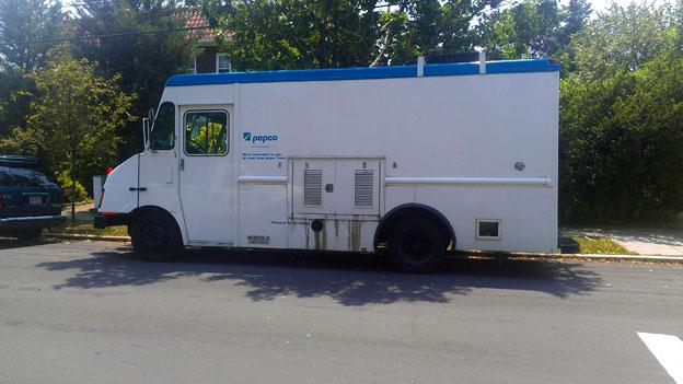 A Pepco truck makes its rounds in Northwest D.C. to restore power in early July. Power outages resulting from the June 29 derecho storm lasted as long as a week.