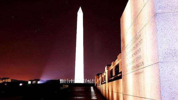 Photo of the Washington Monument taken from inside the WWII Memorial.