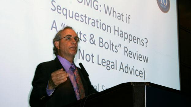 "Stan Soloway, president and CEO of the Professional Services Council, addresses federal contractors at a meeting called ""OMG: What if sequestration happens?"" in Arlington, Va. earlier this month."