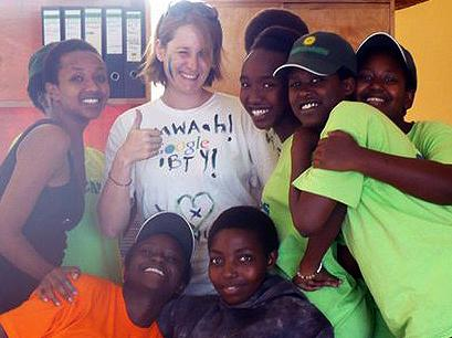 Jennifer Larr (center), 24, is seen here in Rwanda at the Gashora Girls Academy where she was a teacher in 2011. Larr is part of a new generation of young adults focusing on travel, studying abroad and global experiences.