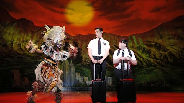 "Mrs. Brown (Phyre Hawkins) gives Elder Price (Mark Evans) and Elder Cunningham (Christopher John O'Neill) a ""Lion King""-inspired send-off at the airport."