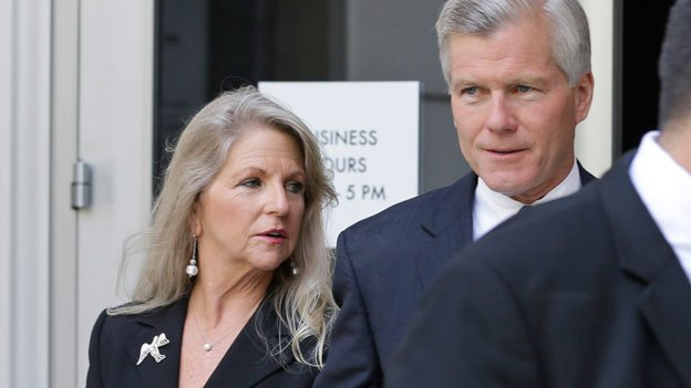 Former Virginia Governor, Bob McDonnell, right, and his wife Maureen, left, leave Federal court after a motions hearing in Richmond, Va.