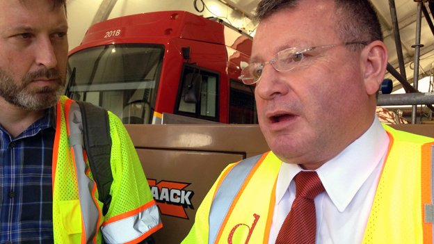 Tim Borchers, right, is the new streetcar launch manager for DDOT, bringing his international transportation experience to bear for the H Street project.